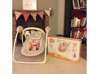 Bright starts portable baby swing.