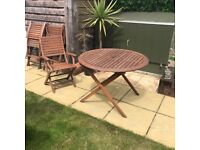 Round garden table plus 4 chairs