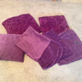 Three purple cusions and covers