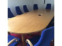 Conference table hardly used in great condition. Complete with 12 chairs