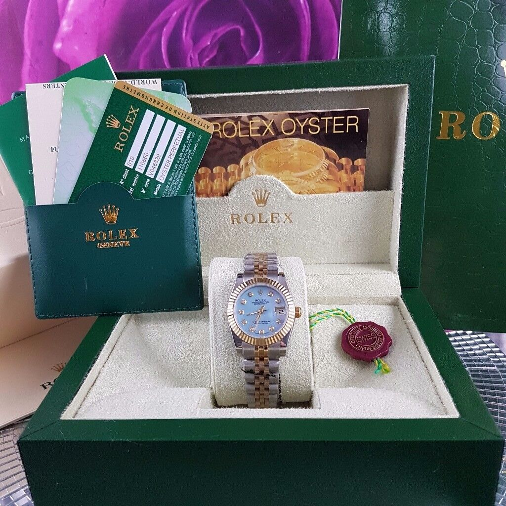 Twotone Rolex Datejust, blue Face. Diamond time stones. Comes Rolex Bagged, Boxed with Paperwork