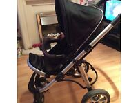 Children's pushchair/buggy Black in colour, includes rain cover and basket.