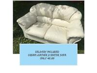 DELIVERY INCLUDED - 2 SEATER CREAM LEATHER SOFA - GOOD CLEAN CONDITION - DELIVERY AVAILABLE TODAY