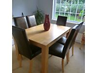 For Sale: Solid oak dining table and six chairs