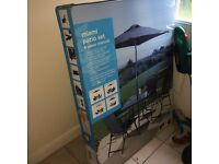 BRAND NEW STILL IN BOX - 4 chairs, 1 square table, 1 parasol with crank handle - BARGAIN BARGAIN!!