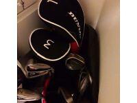 Extended mens Dunlop golf clubs.