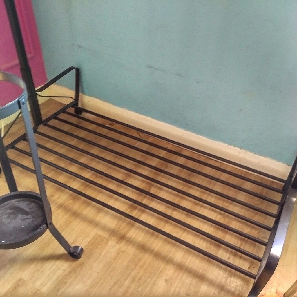 ikea metal hanging rail with shoe rack and umbrella stand in