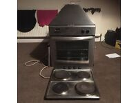 buit in electric oven hob and extractor fan