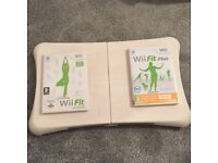 Nintendo Wii with fit boards and games