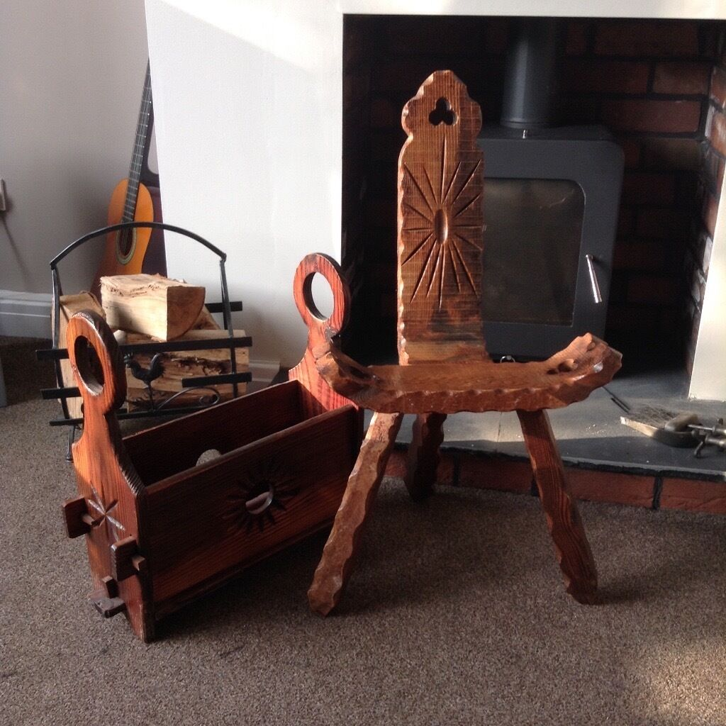 Quirky wooden fireside chair and log storage, paper rack. Log burner
