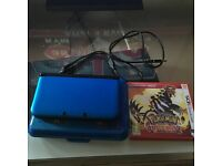 3DS XL with Pokemon omega ruby, charger and case