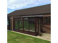 Conservatory - brown frame - with glass - Carlisle