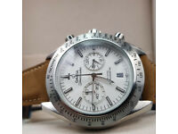 Rossco's Watches. Omega Speedmaster Co Axial. Silver Casing with Brown Leather Strap and white Face.