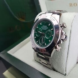 Green faced Rolex Daytona with silver oyster bracelet comes complete with rolex bag box and papers