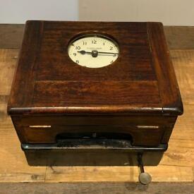 1900s Clocking in machine