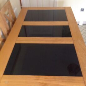 Light oak wood dining table with granite inlay and 6 chairs