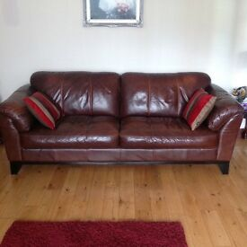 Brown leather three seater and two seater suite