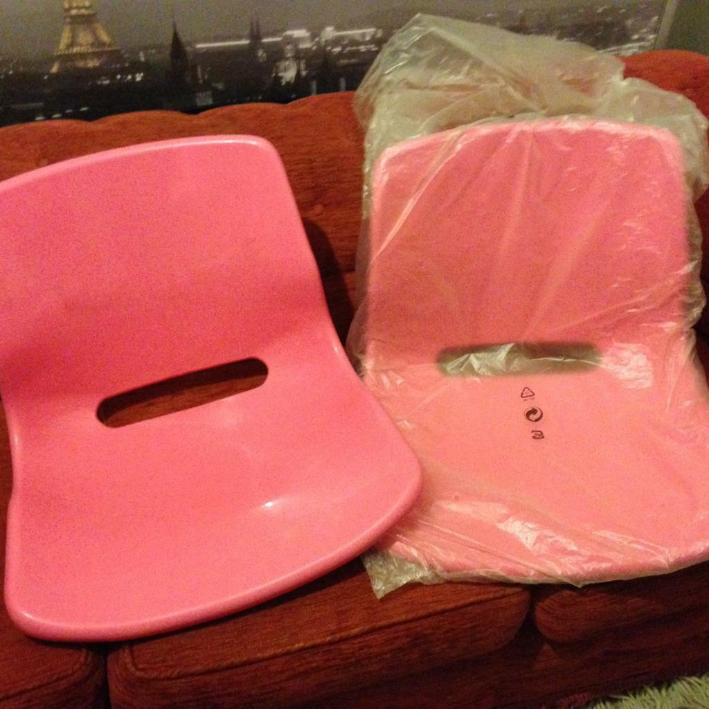 Two pink IKEA seats