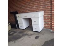 white Glass dressing table with drawers.