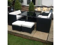 Rattan garden patio table and 2 sofas, 2 stools with cream cushions £275 Ono tel 07966921804