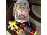 Fisher price pink butterfly baby rocker complete with activity bar and vibrate with three baby toys