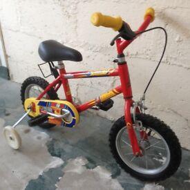 Boys bike with stabalisers.