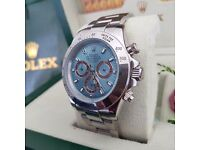 Blue faced Rolex Daytona with all silver casing & all silver oyster bracelet. Comes in Rolex box bag