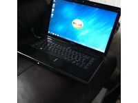 ### Dell 1545 glossy black with charger ####