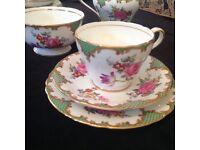 Beautiful vintage floral Aynsley trio with jug and sugar bowl.