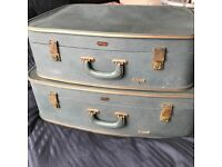 Adorable set of two vintage suitcases