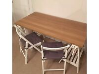 Hardly used adjustable trestle table with wooden chairs with cushions.