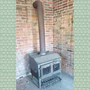 """Antique Cast Iron Wood Stove Glass Doors & 4 Ft 8"""" Pipe"""