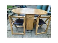 Solid wood space saving table and 4 chairs