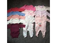 Newborn size baby bodysuit and sleepsuits bundle