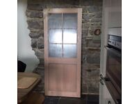 An External 6 Panel Wooden Door - Unused but with slight damage on a corner.