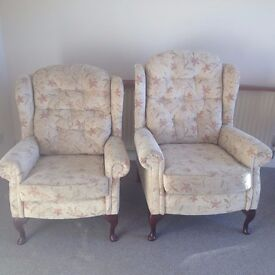 A pair of wingback armchairs.