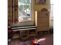 Toddler Montessori shelf: low laquered pine bookcase