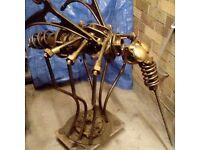 Scrap metal sculpture resting mosquitoe mosquito