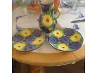 Lovely decorative jug and two plates matching