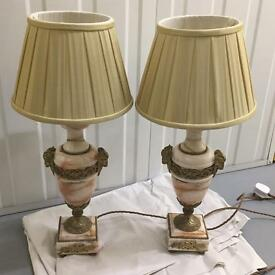 Two antique pink marble lamps