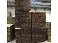 Wooden railway sleepers pressure treated green/brown
