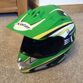 Childs green motor cross helmet