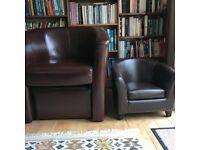 Adult faux leather armchair with matching childs chair both with footstools. Perfect condition