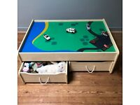 KidKraft playtable - reversible top. Natural wood finish 125x85x44cm 2 drawers with wheels 78x60x22