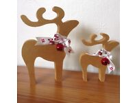 Christmas decorations reindeer pair gold red bell star gazing