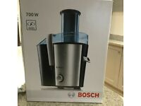 Brand new (in box) Bosch 700W juicer - includes juice and smoothies book