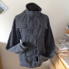 Men's grey casual jacket th grey std feature., zip front with 2 side pockets and yolk false pockets.