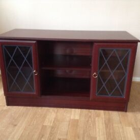 Dark coloured cabinet with 2 doors and shelves