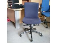 Konig + Neurath dark blue fabric operator chair without armrests