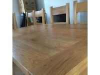 Solid oak extending table + 4 solid oak chairs